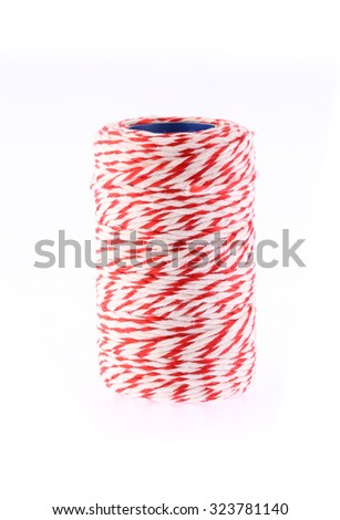 Red and white thread twine spool on white background - stock photo