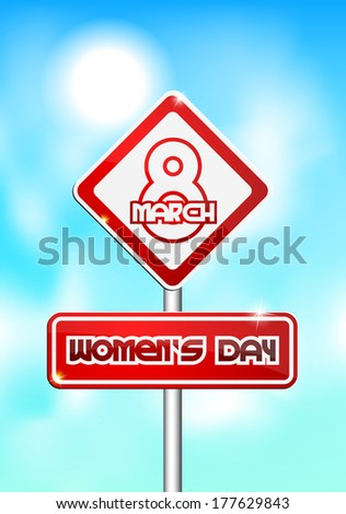 Red and white traffic sign with the inscription March 8 Women's Day on a blue background