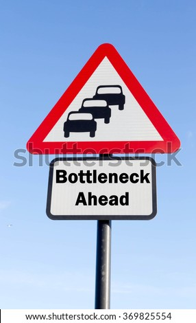 Red and white triangular road sign with a Bottleneck Ahead concept against a partly cloudy sky background - stock photo