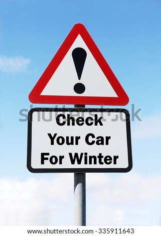Red and white triangular road sign with a Check Your Car For Winter concept against a partly cloudy sky background