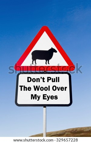 Red and white triangular road sign with a Don't Pull The Wool Over My Eyes Ahead play on words concept against a partly cloudy sky background - stock photo