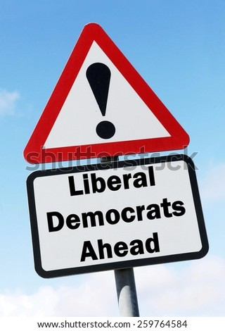 Red and white triangular road sign with a Liberal Democrat Party ahead concept against a partly cloudy sky background