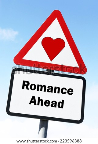 Red and white triangular road sign with a Romance Ahead concept against a partly cloudy sky background