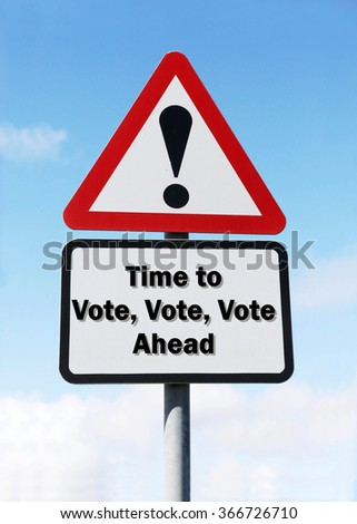 Red and white triangular road sign with a Time To Vote, Vote, Vote Ahead concept against a partly cloudy sky background - stock photo