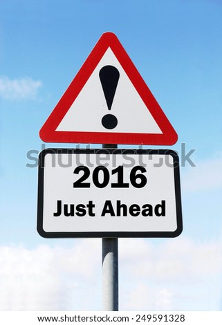 Red and white triangular  road sign with a warning of  2016 Just Ahead concept against a partly cloudy sky background - stock photo