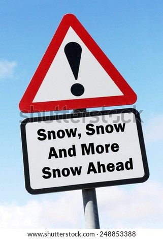 Red and white triangular  road sign with a warning of  Snow, Snow and more Snow Ahead concept against a partly cloudy sky background - stock photo
