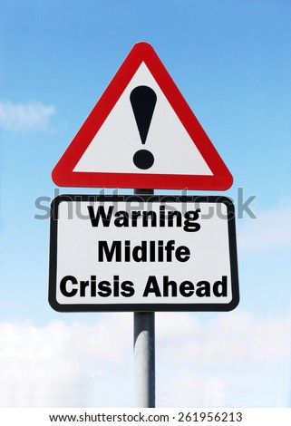 Red and white triangular road sign with warning of a Midlife Crisis Ahead concept against a partly cloudy sky background