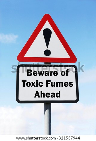 Red and white triangular road sign with warning to Beware of Toxic Fumes ahead concept against a partly cloudy sky background - stock photo