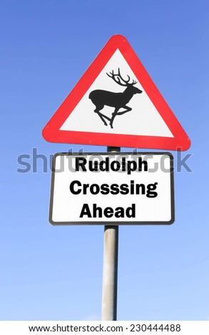 Red and white triangular warning road sign indicating the Santa's reindeer, Rudolph crossing the road ahead - stock photo