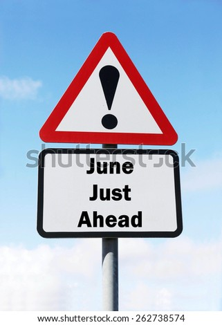 Red and white triangular warning road sign informing that June is Just Ahead concept against a partly cloudy sky background - stock photo