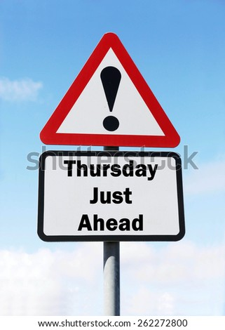 Red and white triangular warning road sign informing that Thursday is Just Ahead concept against a partly cloudy sky background