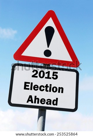 Red and white triangular warning road sign with a warning of the 2015 Election Ahead during an election campaign concept against a partly cloudy sky background - stock photo