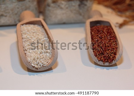 Red and White Uncooked Rice in Big Wooden Spoons