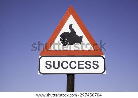 red and white warning triangle traffic sign with a human hand showing thumb up and the words success, business concept for motivation  - stock photo