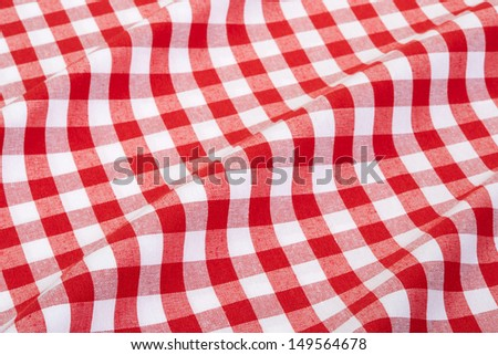 Red and white wavy gingham tablecloth texture background - stock photo