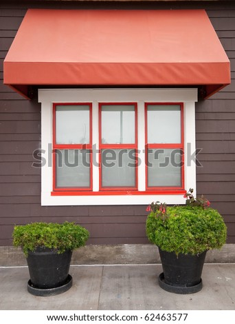 Red and White Window of Old Building - stock photo