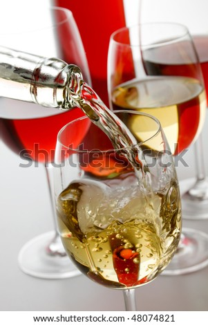 Red and white wine poured in a glass