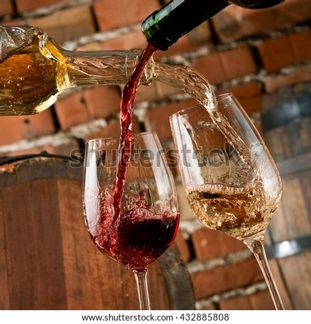 Red and white wine pouring - stock photo