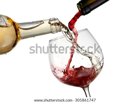 Red and white wine pouring in a glass
