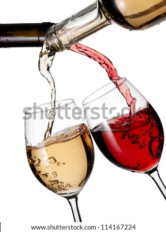 Red and white wine pouring in two glasses - stock photo
