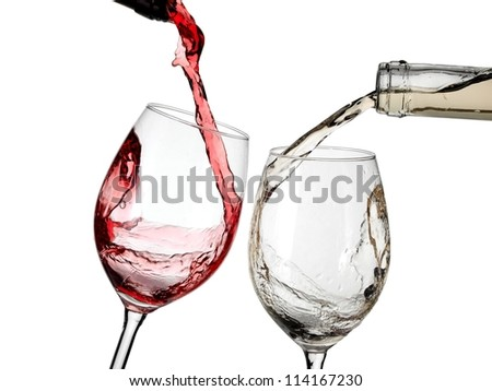 Red and white wine start to pouring - stock photo