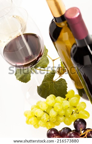 Red and white wine with grapes and wine bottle - stock photo