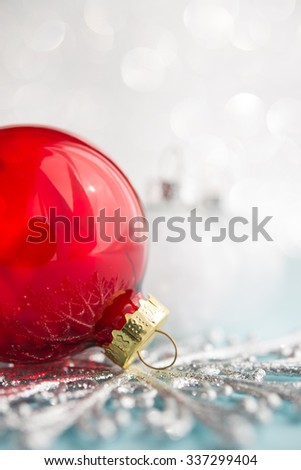 Red and white xmas ornaments on glitter bokeh background. Merry christmas card. Winter holidays. Xmas theme. Happy New Year.