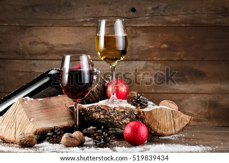 Red and white Xmas wine on wood