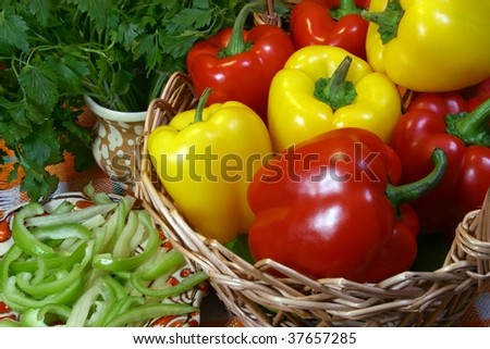 Red and yellow bell peppers in a basket - stock photo