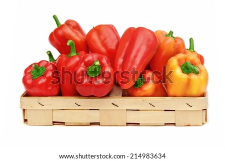 Red and Yellow Bell Peppers in basket isolated on white background - stock photo