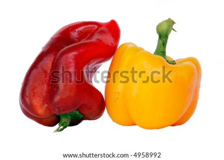 Red and yellow bell-peppers with water drops isolated on white