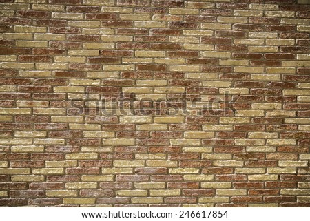 red and yellow brick wall with pattern