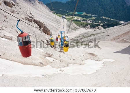 Red and yellow cable car in the Dolomite Mountains near to Cortina