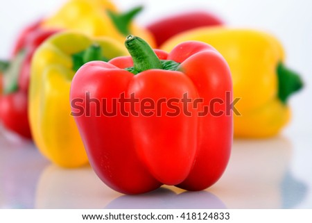 Red and yellow Capsicums over white background