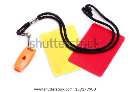 Red and yellow card with whistle isolated on white - stock photo