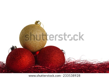 Red and yellow christmas balls with tinsel on white background