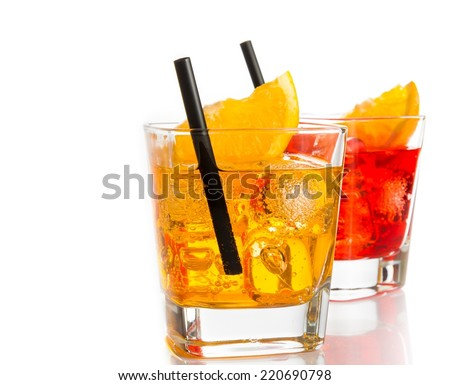red and yellow cocktail with orange slice on top and straw isolated on white background with space for text - stock photo