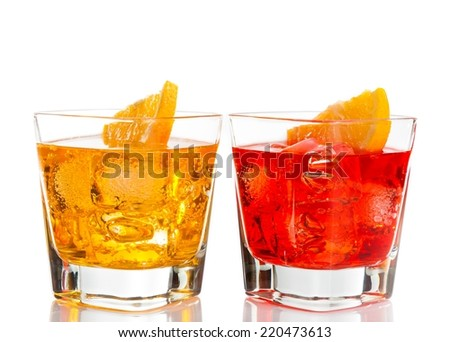 red and yellow cocktail with orange slice on top isolated on white background with space for text