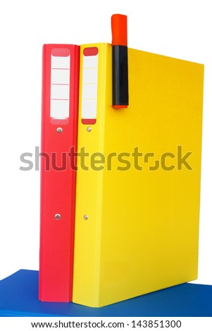 Red and yellow document organizers standing on a blue one (isolated) - stock photo