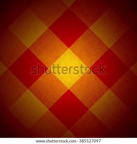 Red and yellow fabric diamond pattern with spotlight