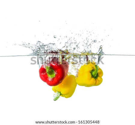 Red and Yellow Paprika Splash in Water Isolated on White Background - stock photo