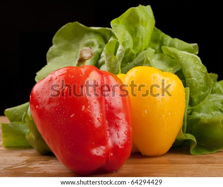 red and yellow peppers and salad