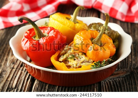 Red and yellow peppers stuffed with meat, rice and vegetables - stock photo