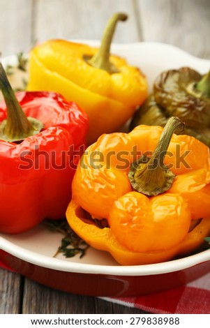 Red and yellow peppers stuffed with meat, rice and vegetables