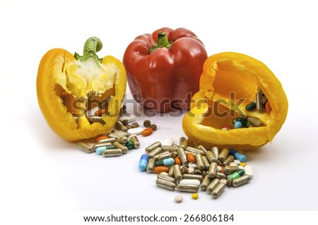 Red and Yellow Peppers with vitamins and drugs - stock photo