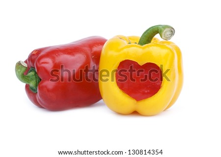 Red and yellow sweet pepper on white background