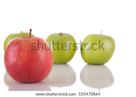 Red apple among green apples - competition concept