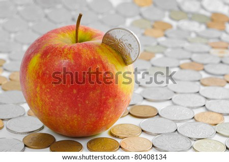 Red apple and chinese coins - stock photo