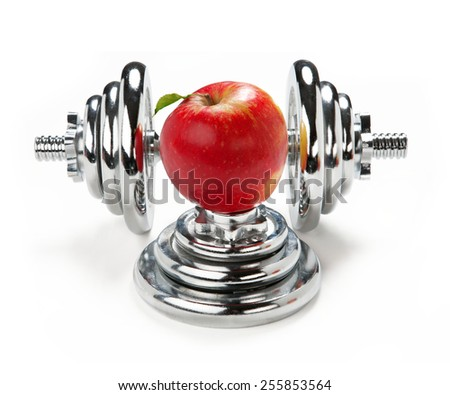 Red apple and dumbbell / weight training equipment on white background   - stock photo
