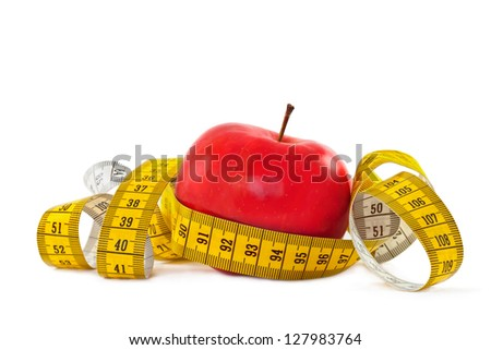 Red apple and measure tape - stock photo